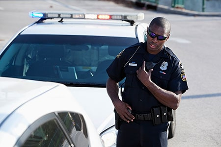 African American Police Officer Pulling Over a Car